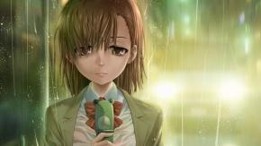Грустная девочка с телефон в руках стоит под дождем